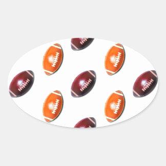 Modelo rojo oscuro y anaranjado del fútbol pegatina ovalada