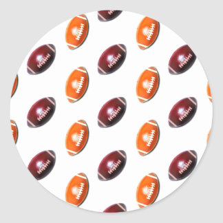 Modelo rojo oscuro y anaranjado del fútbol pegatina redonda