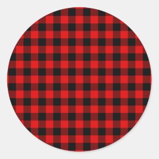 Modelo rojo tradicional de la tela escocesa del pegatina redonda