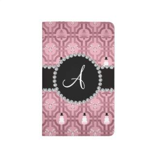 Modelo rosado bonito del enrejado del muñeco de ni cuaderno