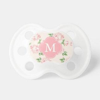 Modelo rosado con monograma de los rosas del chupetes de bebe