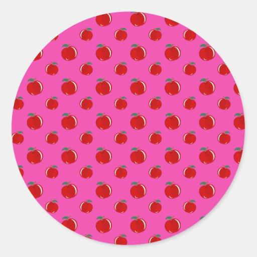 Modelo rosado de la manzana pegatina redonda