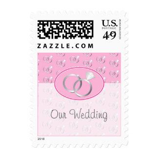 Modelo rosado de los anillos de bodas franqueo