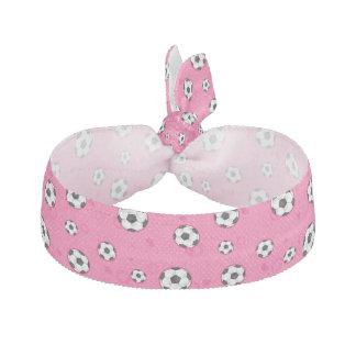 Modelo rosado del balón de fútbol gomas de pelo