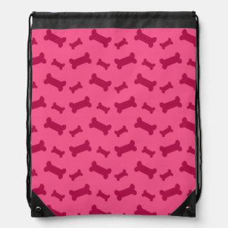 Modelo rosado lindo de los huesos de perro mochila