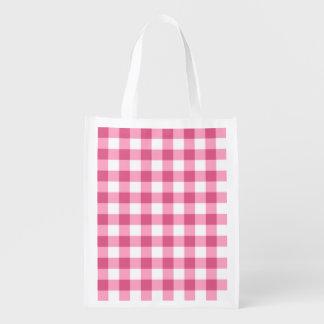 Modelo rosado y blanco del control de la guinga bolsa para la compra