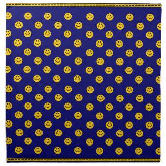 Modelo sonriente amarillo de la cara en azul marin servilleta de papel