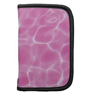 Modelo teñido rosa de la luz de la piscina organizadores