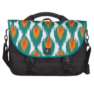 Modelo tribal abstracto anaranjado del diamante de bolsas de portatil