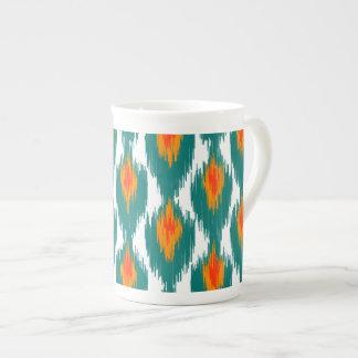 Modelo tribal abstracto anaranjado del diamante de tazas de china