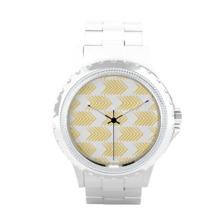 Modelo tribal amarillo de la flecha reloj