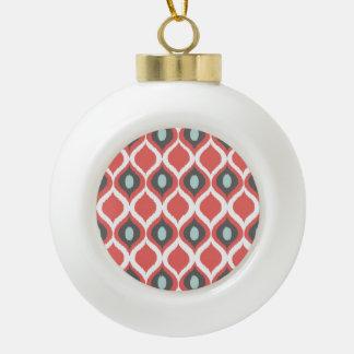 Modelo tribal geométrico rojo de la impresión de adorno de cerámica en forma de bola