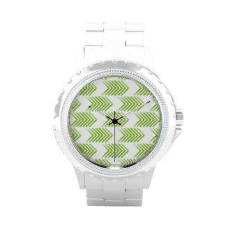 Modelo tribal verde de la flecha reloj