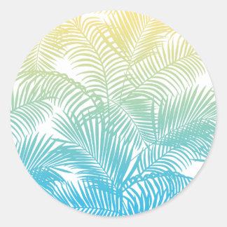 Modelo tropical de las palmeras del amarillo pegatina redonda