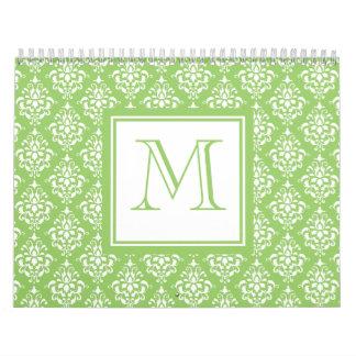 Modelo verde 1 del damasco con el monograma calendario de pared