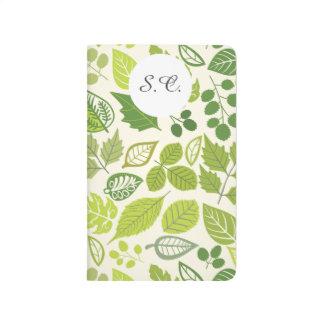 Modelo verde de la hoja cuaderno grapado