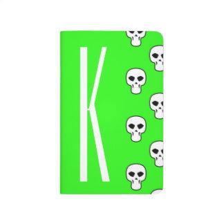 Modelo verde de neón de los cráneos cuaderno