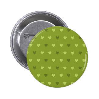 Modelo verde del corazón pin