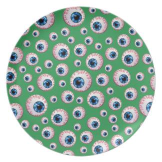 Modelo verde del globo del ojo platos
