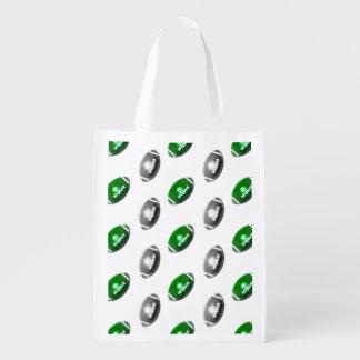 Modelo verde y de plata del fútbol bolsas para la compra