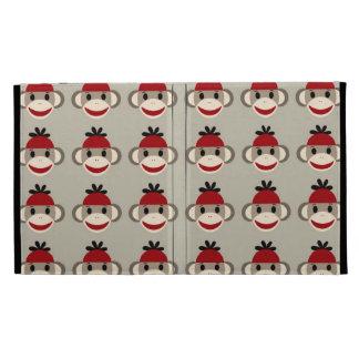 Modelos felices sonrientes del mono rojo del calce