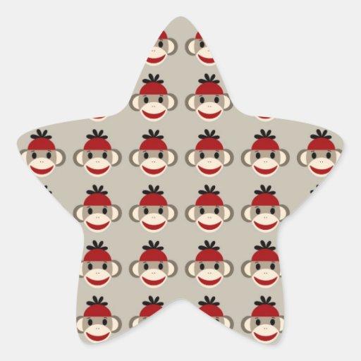 Modelos felices sonrientes del mono rojo del pegatina en forma de estrella