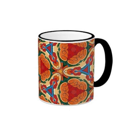 Modelos multicolores coloridos de la repetición taza