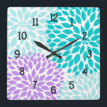 """Modern Dahlia flowers turquoise lavender purple Square Wall Clock<br><div class=""""desc"""">This modern turquoise and lavender clock is available in square or round.  Numbers can be removed.  Need a specific color for your decor?  Just ask the designer!  Feel free to contact us anytime with questions.</div>"""