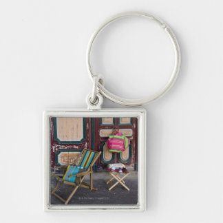 Modern day deck chairs and beach bags for sale keychain