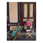Modern day deck chairs and beach bags for sale postcard