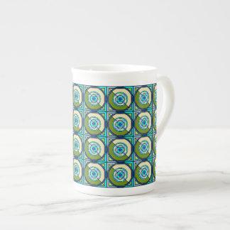 Modern geometric quilt design in Green & Blue Tea Cup