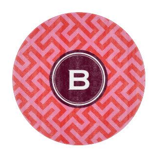 Modern red greek key geometric patterns monogram cutting board