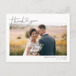 """Modern Script with Heart Wedding Thank You Photo Postcard<br><div class=""""desc"""">Elegant and simple wedding thank you template card featuring a hand lettered typography script text with a heart between the words. This casual script and the white space gives a simple and minimalistic feel. Customize this product by inserting your own wedding photo and editing the message on the back of...</div>"""