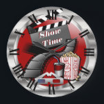 """Modern Showtime Movie Theater Large Clock<br><div class=""""desc"""">Modern Showtime Movie Cinema Clock. Makes a great to add to your theater room, family room or recreational room or business. Made with high resolution vector and/or digital graphics for a professional print. NOTE: (THIS IS A PRINT. All zazzle product designs are &quot;prints&quot; unless otherwise stated under &quot;About This Product&quot;...</div>"""