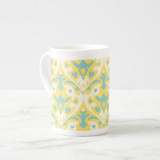 Modern teal yellow girly ikat tribal pattern tea cup
