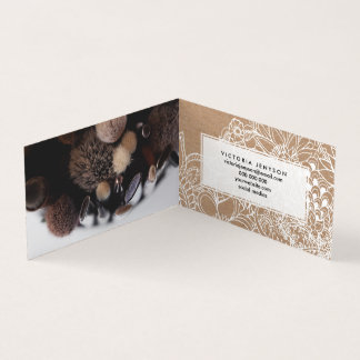Modern white hand drawn floral illustration on rus business card