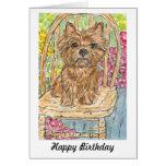 Mojón Terrier que se sienta en tarjeta de cumpleañ