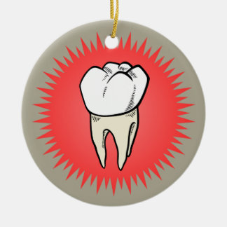 Molar freshly pulled, proudly shown christmas ornaments
