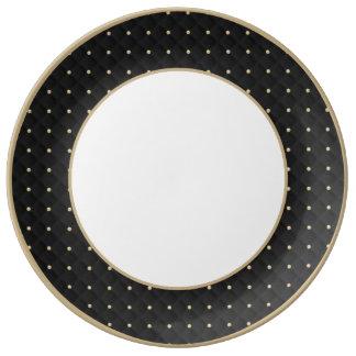 Moldeado hinchado negro y acolchado plato de cerámica