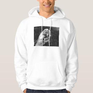 mole in hand bw against grass.jpg hooded sweatshirt