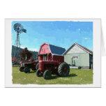 Molino de viento, tractores antiguos y edificios d tarjetón