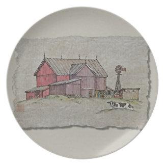 Molino de viento y vaca del granero plato