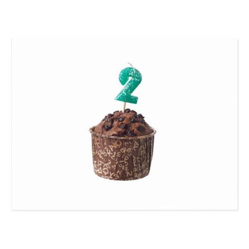 Mollete del chocolate con la vela del cumpleaños postales