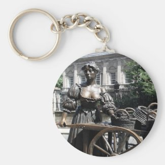 Molly Malone and her wheelbarrow in Dublin, Ireland on a  key ring. This statue on this keychain is known locally as The Tart With The Cart, The Dish With The Fish, The Trollop With The Scallop(s), The Dolly With the Trolley, and The Flirt in the Skirt.