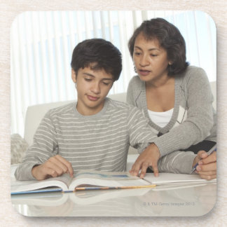 mom helping son with homework beverage coaster