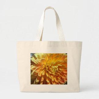 Momias el flor de oro enorme de la palabra bolsas