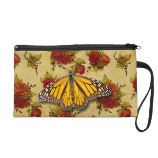 MONARCH AND ROSES WRISTLET PURSES