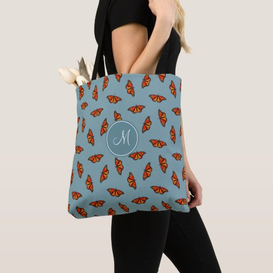 Monarch butterflies pattern on blue monogrammed tote bag