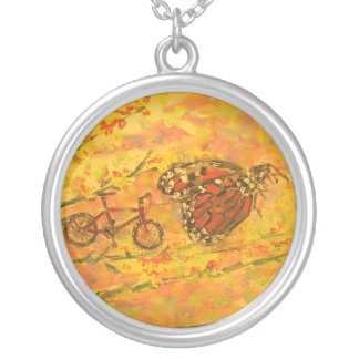 monarch butterfly and bicycle round pendant necklace
