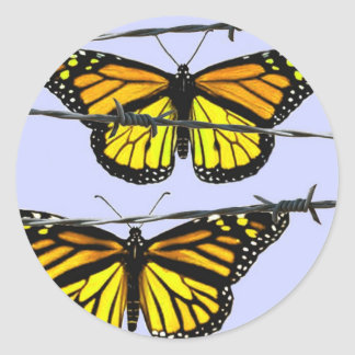 Monarch butterfly  behind barbed wire classic round sticker